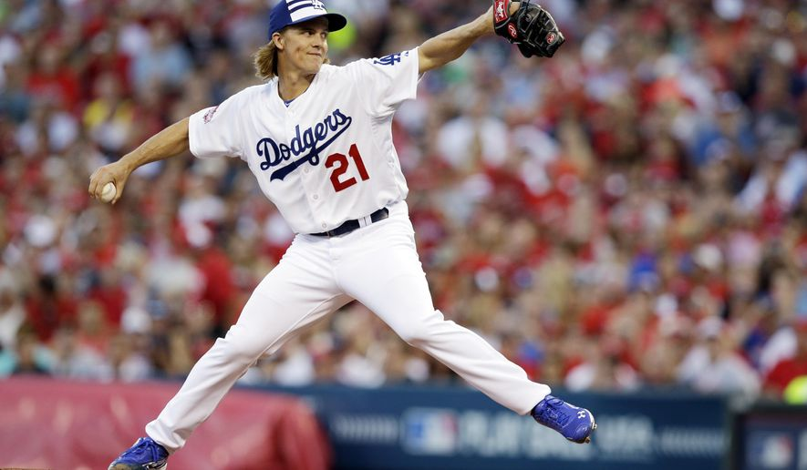 National League's Zack Greinke, of the Los Angeles Dodgers, throws during the first inning of the MLB All-Star baseball game, Tuesday, July 14, 2015, in Cincinnati. (AP Photo/John Minchillo)