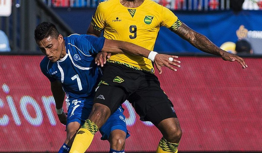 El Salvador's Darwin Ceren, left, loses the ball to Jamaica's Giles Barnes during a CONCACAF Gold Cup soccer match in Toronto on Tuesday, July 14, 2015. (Aaron Vincent Elkaim/The Canadian Press via AP)