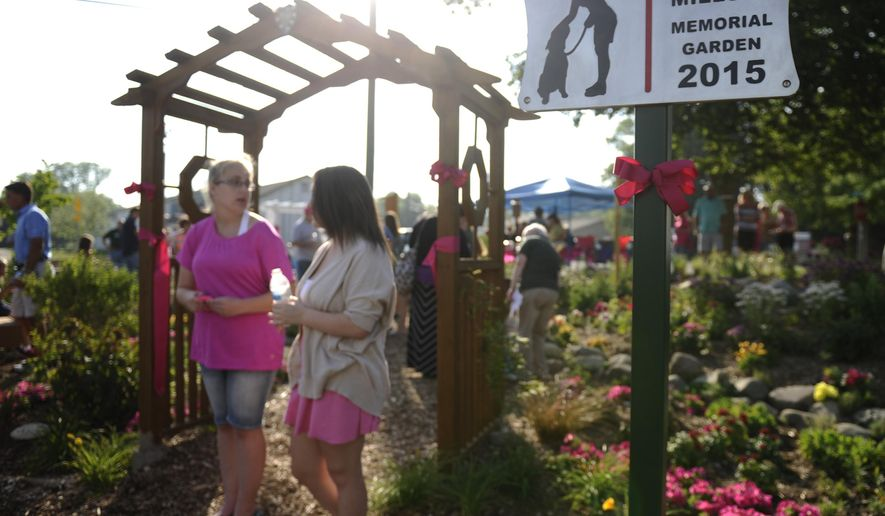 Attendees walk thru the April Millsap Memorial Garden in Armada, Mich., on Monday, July 13, 2015.  The garden was built in memory of Millsap, a 14-year-old girl killed last year.   (Elizabeth Conley/Detroit News via AP)  DETROIT FREE PRESS OUT; HUFFINGTON POST OUT