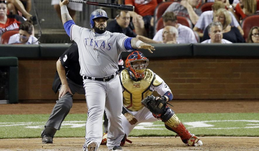 American League's Prince Fielder, of the Texas Rangers, hits a sacrifice fly during the seventh inning of the MLB All-Star baseball game, Tuesday, July 14, 2015, in Cincinnati. (AP Photo/Michael E. Keating )