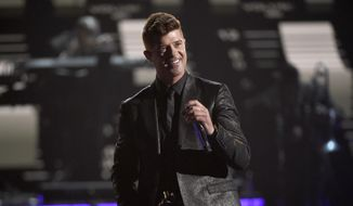 In this Sunday, June 28, 2015, file photo, Robin Thicke performs during a tribute to Smokey Robinson at the BET Awards at the Microsoft Theater in Los Angeles. (Photo by Chris Pizzello/Invision/AP, File)