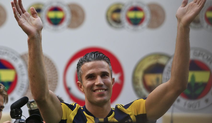 Robin Van Persie of Netherlands waves to Fenerbahce fans during his presentation at the team's Sukru Saracoglu Stadium in Istanbul, Tuesday, July 14, 2015. The Dutch international player signed a contract with the Turkish club. (AP Photo/Lefteris Pitarakis)