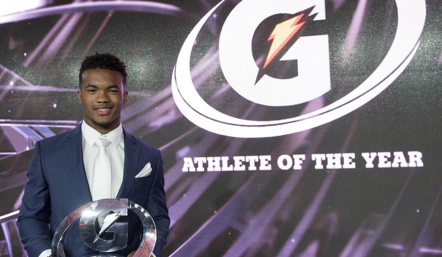 In this photo provided by Gatorade, Kyler Murray, a quarterback from Allen (Texas) High School, holds his trophy after being named male national prep athlete of the year, Tuesday, July 14, 2015, in Los Angeles. Candace Hill, from Rockdale County High School in Conyers, Ga., was named the 2015 Gatorade Female Athlete of the Year, but was unable to attend the ceremony because she is competing out of the country. (Susan Goldman/Gatorade via AP)