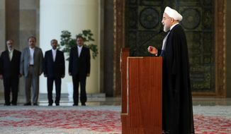 Iran's president Hassan Rouhani addresses the nation in a televised speech minutes after a landmark nuclear agreement was announced in Vienna, in Tehran, Iran, Tuesday, July 14, 2015. After long, fractious negotiations, world powers and Iran struck a historic deal Tuesday to curb Iran's nuclear program in exchange for billions of dollars in relief from international sanctions - an agreement aimed at averting the threat of a nuclear-armed Iran and another U.S. military intervention in the Middle East. (AP Photo/Ebrahim Noroozi)