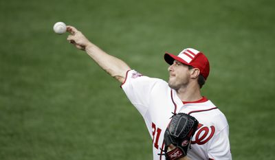 National League's Max Scherzer, of the Washington Nationals, throws before before formal batting practice before the MLB All-Star baseball game, Tuesday, July 14, 2015, in Cincinnati. (AP Photo/Michael E. Keating )