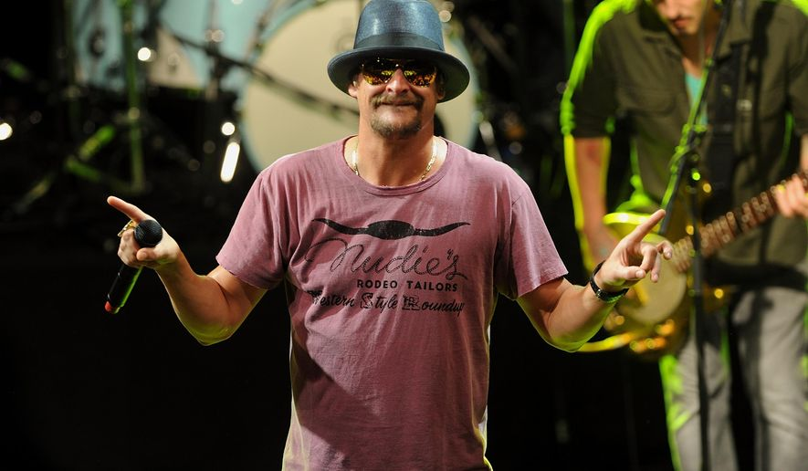 FILE - This May 5, 2015 file photo shows musician Kid Rock performing during  National Concert Day in New York. Activists in Detroit trying to persuade Kid Rock to stop displaying the Confederate flag at concerts plan to meet this week with General Motors over the Chevrolet brand's sponsorship of the musician's summer tour. (Photo by Brad Barket/Invision/AP, File)