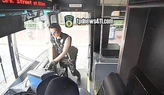 Boston prosecutors have dropped a slew of charges against Kevin Young, 26, who was arrested Friday after he boarded a city bus wearing a fake bullet belt — a garment popular in the punk and metal music scenes. (Massachusetts Bay Transportation Authority via CBS)