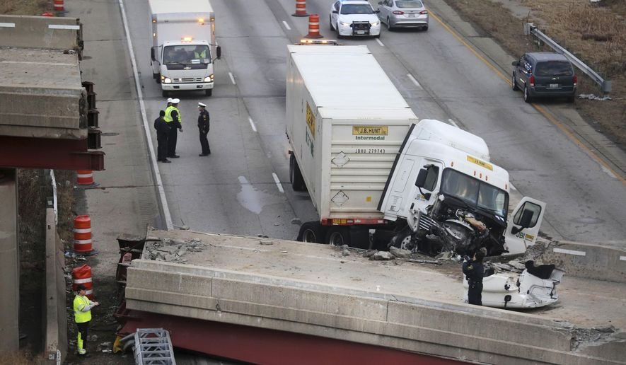 FILE-This Tuesday, Jan. 20, 2015 file photo shows work continuing in the aftermath of the bridge collapse on Interstate 75, in Cincinnati. Federal officials have cited a company in charge of demolishing a highway overpass that collapsed and killed a construction worker for two safety violations and fined it $14,000. (Liz Dufour/The Cincinnati Enquirer via AP, file)  MANDATORY CREDIT;  NO SALES