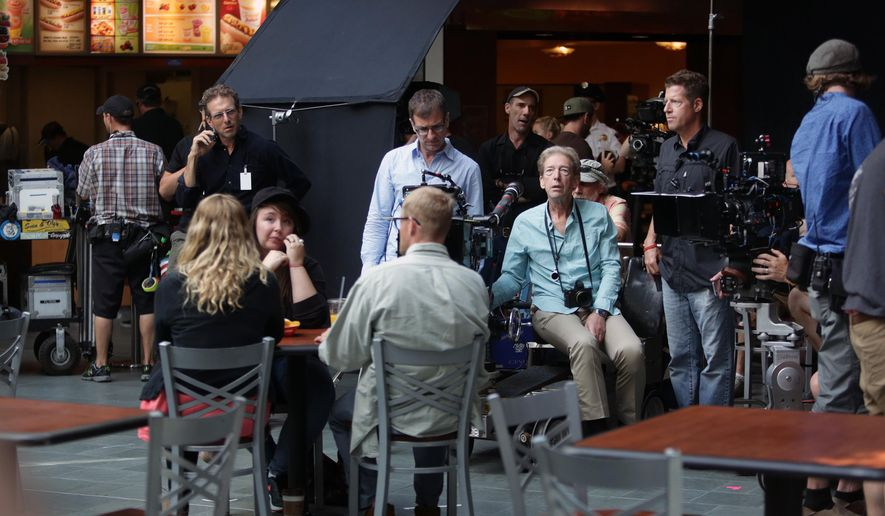 "Director of Photography Fred Elmes, center, and other crew members and actor stand-ins prepare to shoot a scene of ""Wilson"" at the Mall of America in Bloomington, Minn. Tuesday, July 14, 2015. It's the biggest movie to be made in Minnesota in several years, and came in part due to lawmakers restoring some funding to a program that gives rebates to film companies.  (Jeffrey Thompson/Minnesota Public Radio via AP) MANDATORY CREDIT"