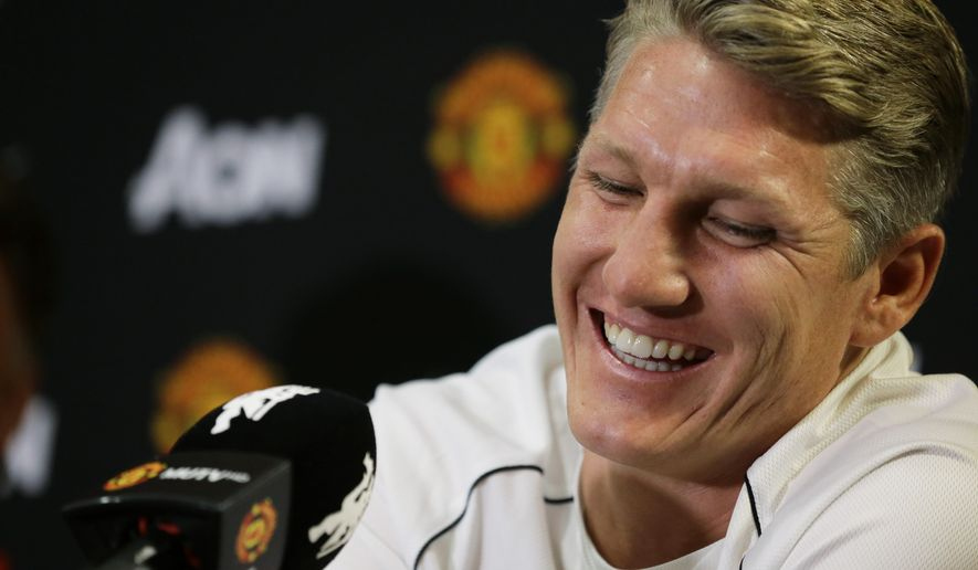 Bastian Schweinsteiger smiles as he talks to reporters after being introduced as a new singing with Manchester United, during a news conference Wednesday, July 15, 2015, in Bellevue, Wash. Manchester United is in the Seattle are for an international friendly soccer match against Mexico's Club America to be played Friday. (AP Photo/Ted S. Warren)