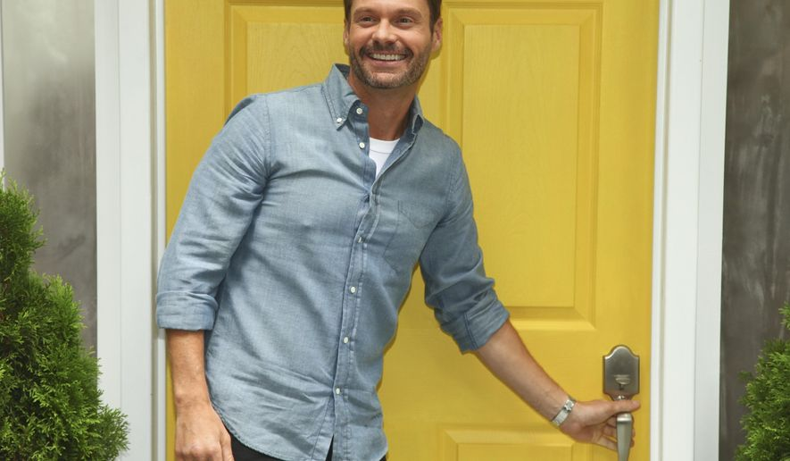 "Ryan Seacrest participates in the ""Knock Knock Live"" pop up event outside the News Corporation/Fox Building on Tuesday, July 14, 2015, in New York. (Photo by Andy Kropa/Invision/AP)"