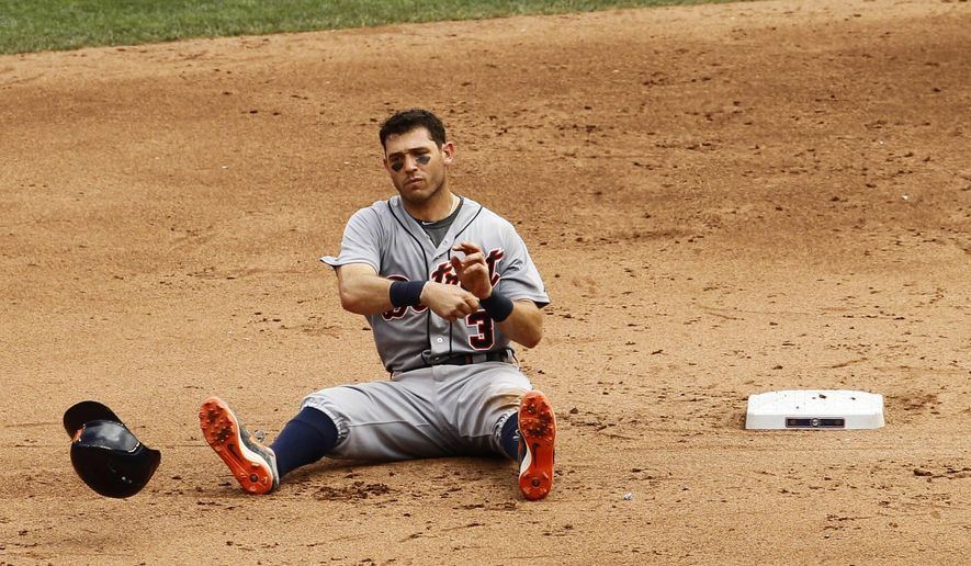 Detroit Tigers' Ian Kinsler (3) tosses his batting helmet after being forced out at second base by Minnesota Twins shortstop Danny Santana during the sixth inning of a baseball game in Minneapolis, Sunday, July 12, 2015. The Twins won 7-1. (AP Photo/Ann Heisenfelt)