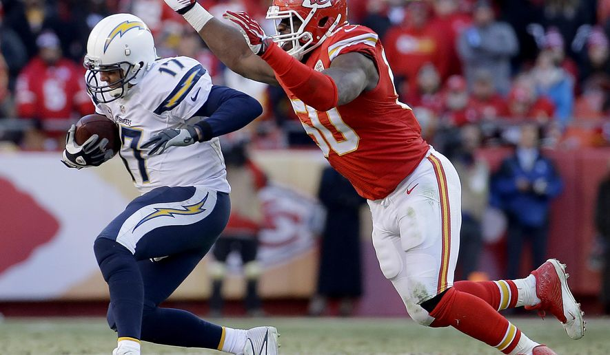 FILE - In this Dec. 28, 2014, file photo, Kansas City Chiefs outside linebacker Justin Houston (50) sacks San Diego Chargers quarterback Philip Rivers (17) during the second half of an NFL football game in Kansas City, Mo. A person familiar with the situation tells The Associated Press that the Chiefs and All-Pro linebacker Justin Houston have agreed to a six-year, $101 million contract that includes $52.5 million in guarantees. The person spoke on condition of anonymity Wednesday, July 15, 2015,  because the deal has not been announced.   (AP Photo/Charlie Riedel, File)