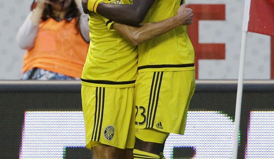 Columbus Crew  forward Kei Kamara, right, celebrates with defender Michael Parkhurst after scoring his goal during the first half of an MLS soccer match against the Chicago Fire  Wednesday, July 15, 2015, in Bridgeview, Ill. (AP Photo/Nam Y. Huh)