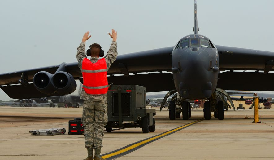 A B-52H Stratofortress is marshalled to a stop on Barksdale Air Force Base, La., July 2, 2015. Two B-52s flew an approximate 44-hour roundtrip mission to Australia where they integrated with Royal Australian Air Force ground forces in the region to conduct a conventional weapons exercise and perform a low approach at RAAF Base Tindal. (U.S. Air Force photo/Senior Airman Benjamin Raughton)
