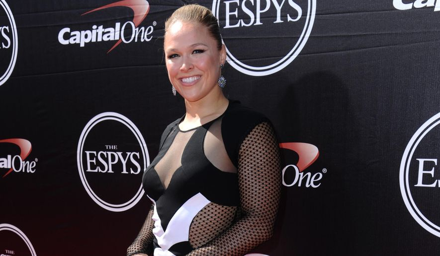 Mixed martial artist Ronda Rousey arrives at the ESPY Awards at the Microsoft Theater on Wednesday, July 15, 2015, in Los Angeles. (Photo by Richard Shotwell/Invision/AP) ** FILE **