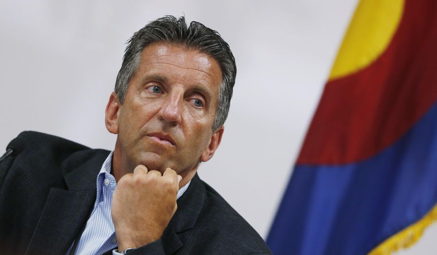 Larry Wolk, executive director and chief medical officer of the Colorado Department of Health, listens to testimony to add post-traumatic disorder to the list of ailments eligible for treatment with medical marijuana during a hearing before the Colorado Board of Health Wednesday, July 15, 2015, in Denver.  If approved, Colorado would become the 10th state to consider PTSD a qualifying condition for medical pot. (AP Photo/David Zalubowski)