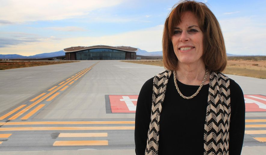FILE - This Dec. 9, 2014, file photo shows Christine Anderson, executive director of the New Mexico Spaceport Authority, posing for a photo at the end of the taxiway at Spaceport America in Upham, N.M. Anderson testified before the Legislative Finance Committee in Alamogordo, N.M., on Wednesday, July 15, 2015, about Spaceport America's spending on security and firefighting services. (AP Photo/Susan Montoya Bryan,File)