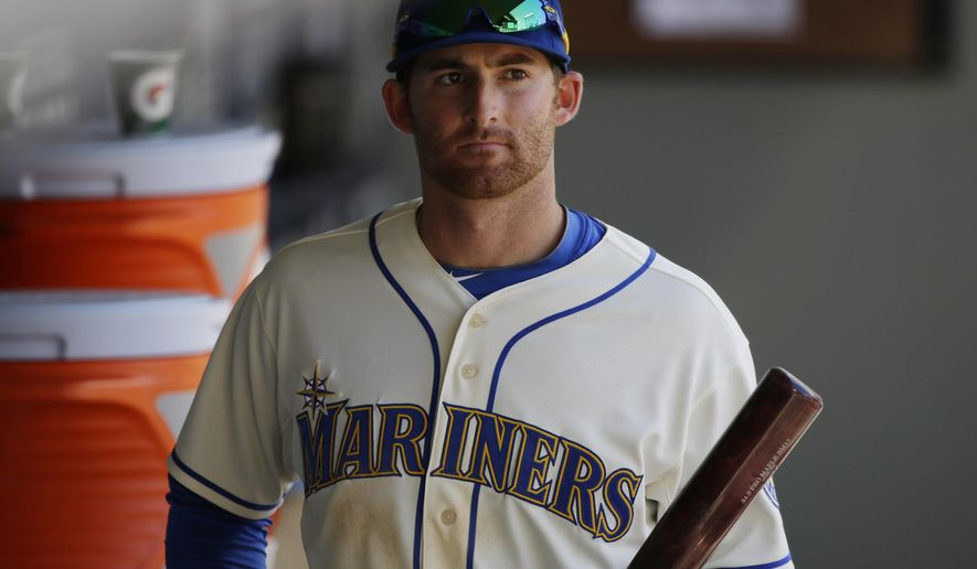 Seattle Mariners' Brad Miller walks through the dugout after the Los Angeles Angels defeated the Mariners 10-3 in a baseball game, Sunday, July 12, 2015, in Seattle. (AP Photo/Ted S. Warren)