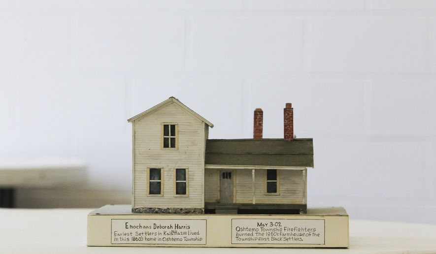 Murphy Darden's model of Enoch and Deborah Harris' home from the 1860's is on display in the 'Going Back in Time' exhibition at Douglass Community Association in Kalamazoo, Mich., on Tuesday July 14, 2015. They were the earliest black settlers from the early 1800's in Kalamazoo County. (Crystal Vander Weit/Kalamazoo Gazette-MLive Media Group via AP) ALL LOCAL TELEVISION OUT; LOCAL TELEVISION INTERNET OUT; MANDATORY CREDIT