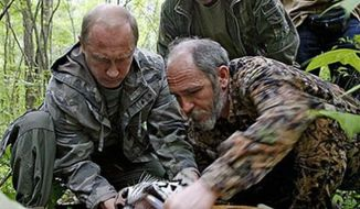 Then Russian Prime Minister Vladimir Putin releases a Siberian tiger into the wild with a satellite tracker in Russia's Far East, Aug. 31, 2008. (The Associated Press) ** FILE **