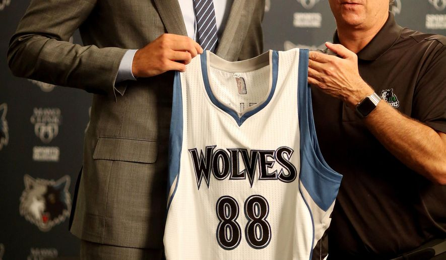 Nemanja Bjelica, Euro League MVP, left, poses with for a photo with Flip Saunders President of Basketball Operations of Minnesota Timberwolves Wednesday,  July 15, 2015, in Minneapolis.   Bjelica has been signed by the Timberwolvs,   Jerry Holt /Star Tribune via AP)  MANDATORY CREDIT; ST. PAUL PIONEER PRESS OUT; MAGS OUT; TWIN CITIES LOCAL TELEVISION OUT