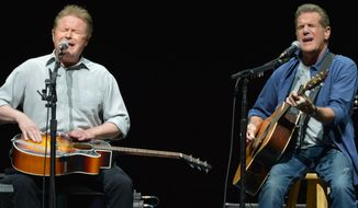 """Don Henley, left, and Glenn Frey of The Eagles perform at the Forum in Los Angeles n this Jan. 15, 2014 photo. A list of six Kennedy Center honorees were announced Wednesday, which includes """"Star Wars"""" creator George Lucas, groundbreaking actresses Rita Moreno and Cicely Tyson, singer Carole King, rock band the Eagles and acclaimed music director Seiji Ozawa. (Photo by John Shearer/Invision/AP, File)"""