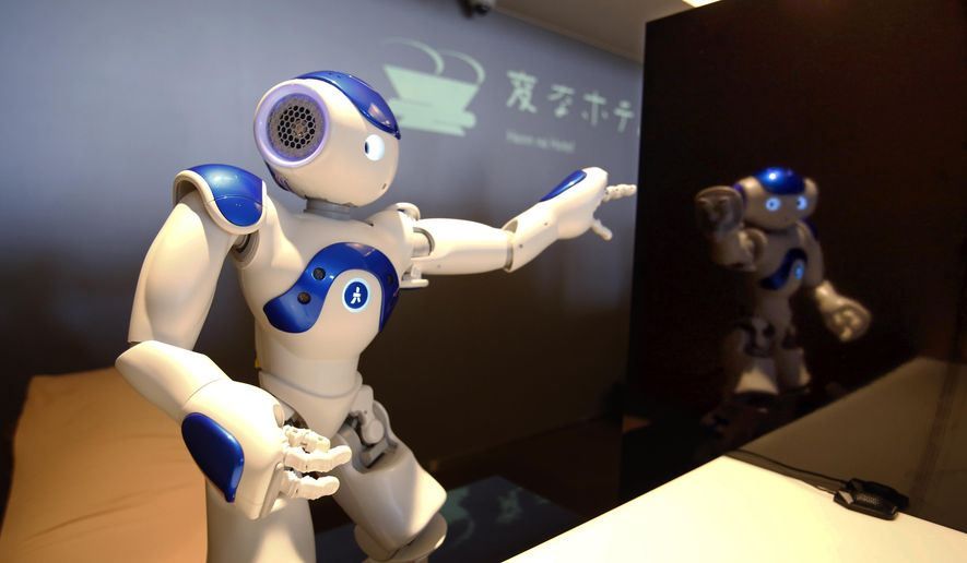 """A receptionist robot performs during a demonstration for the media at the new hotel, aptly called Henn na Hotel or Weird Hotel, in Sasebo, southwestern Japan, Wednesday, July 15, 2015. From the receptionist that does the check-in and check-out to the porter that's a stand-on-wheels taking luggage up to the room, the hotel, that is run as part of Huis Ten Bosch amusement park, is """"manned"""" almost totally by robots to save labor costs. (AP Photo/Shizuo Kambayashi)"""