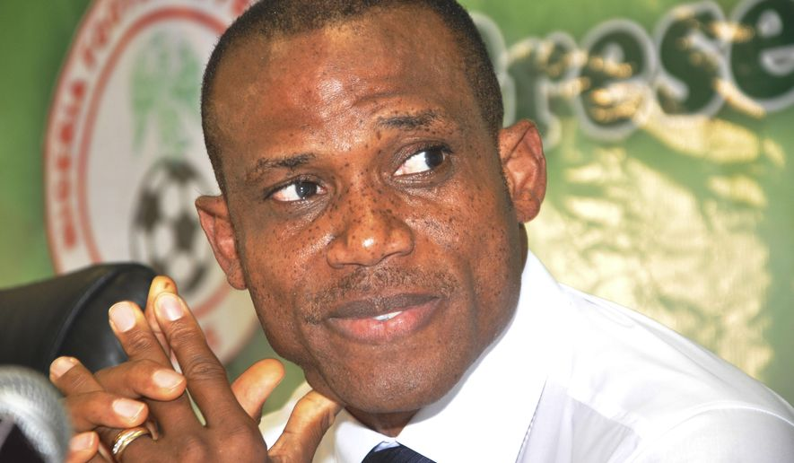 Former Nigeria midfielder Sunday Oliseh smiles during a ceremony to confirm him as the new Nigeria soccer coach at the National Stadium in Abuja, Nigeria, Wednesday, July 15, 2015. Former midfielder and captain Sunday Oliseh was confirmed as the new coach of Nigeria on Wednesday. Oliseh took over from another former captain, Stephen Keshi, who was fired this month for breaching his contract by applying to be Ivory Coast coach. (AP Photo/Olamikan Gbemiga)