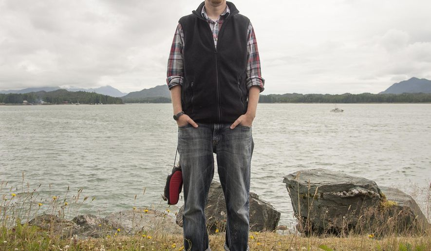 In this July 10, 2015 photo, Pastor Peter Epler poses for a portrait in Ketchikan, Alaska. Epler is walking barefoot in July to raise money for a charity that makes $15 pairs of shoes for poor children in other countries. (Taylor Balkom/Ketchikan Daily News via AP)