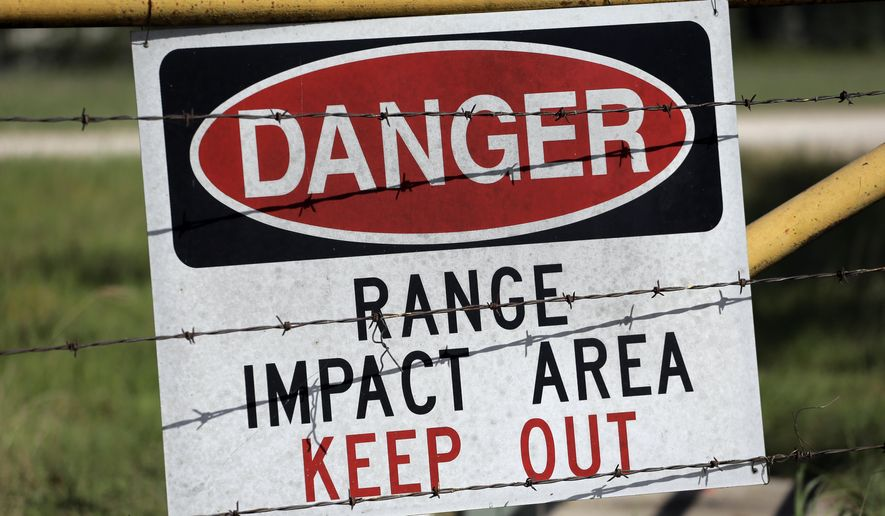 A warning sign is posted at a gate entrance at Texas Army National Guard Camp Swift, Wednesday, July 15, 2015, in Bastrop, Texas. Jade Helm 15, a summer military training exercise that has aroused alarm among archconservatives Texans, begins Wednesday outside the Central Texas town of Bastrop. (AP Photo/Eric Gay)