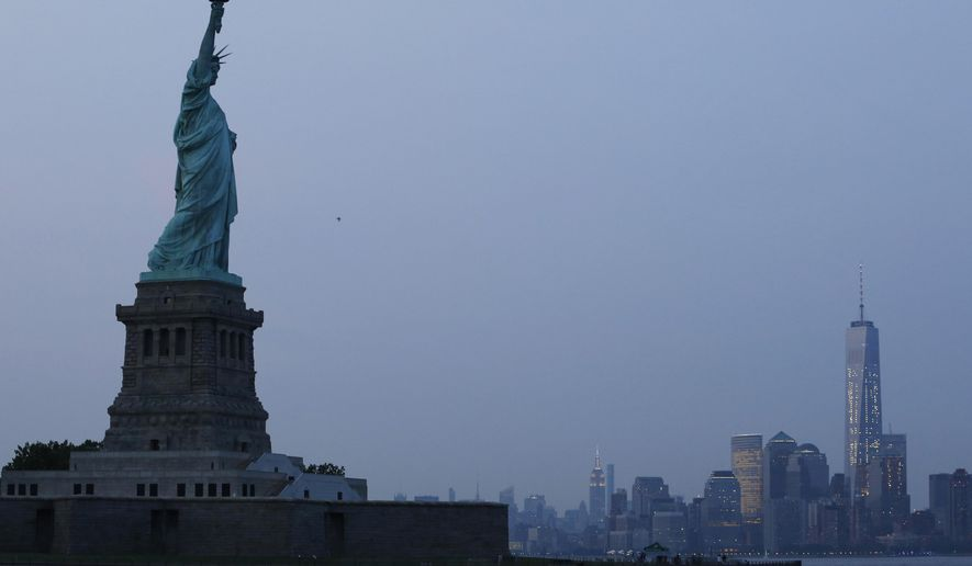 FILE - In this Tuesday, July 7, 2015, file photo, the Statue of Liberty stands in New York harbor with the New York City skyline in the background. The Federal Reserve of New York releases its July survey of manufacturers on Wednesday, July 15, 2015. (AP Photo/Kathy Willens, File)