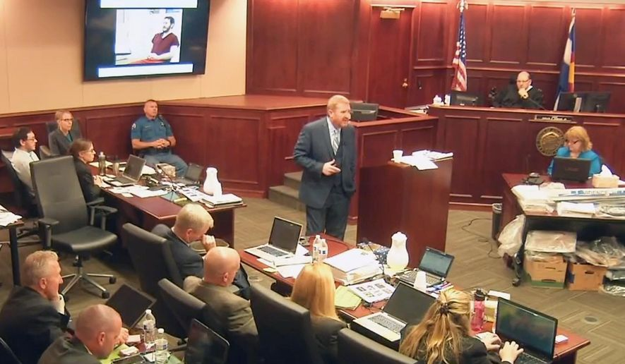 In this image taken from video, accused Colorado theater shooter James Holmes, on the upper far left, listens to defense attorney Daniel King give closing arguments during his trial, in Centennial, Colo., Tuesday, July 14, 2015. (Colorado Judicial Department via AP, Pool)