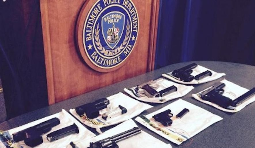 A July 2015 file photo showing guns seized during a raid on one of the Safe Streets anti-violence program's office.  (WBAL-TV/Barry Simms) **FILE**