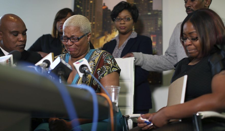 Shavon Bland, back left, Sharon Cooper, back center, and Sierra Cole, right, Sandra Bland's oldest sister Shante Needham, center, becomes emotional as she tries to answer a question from a reporter, during news conference about their sister's death, Thursday, July 16, 2015 in Chicago.  Their attorney Cannon Lambert, left, and their uncle Paul Needham, right, were also present. Sandra Bland, a 28-year-old woman who authorities say hanged herself in a Texas jail after her arrest for allegedly kicking an officer following a traffic stop gave no indication she was in such an emotional state that she would kill herself, her sister said Thursday. (Abel Uribe/Chicago Tribune via AP) MANDATORY CREDIT CHICAGO TRIBUNE; CHICAGO SUN-TIMES OUT; DAILY HERALD OUT; NORTHWEST HERALD OUT; THE HERALD-NEWS OUT; DAILY CHRONICLE OUT; THE TIMES OF NORTHWEST INDIANA OUT; TV OUT; MAGS OUT; NO SALES