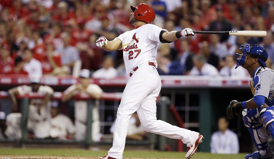 National League's Jhonny Peralta, of the St. Louis Cardinals, hits an RBI single during the second inning of the MLB All-Star baseball game, Tuesday, July 14, 2015, in Cincinnati. (AP Photo/John Minchillo)