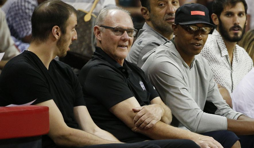 Sacramento Kings head coach George Karl , second from left, watches his team play against the Golden State Warriors during the first half of an NBA summer league basketball game Monday, July 13, 2015, in Las Vegas. (AP Photo/John Locher)