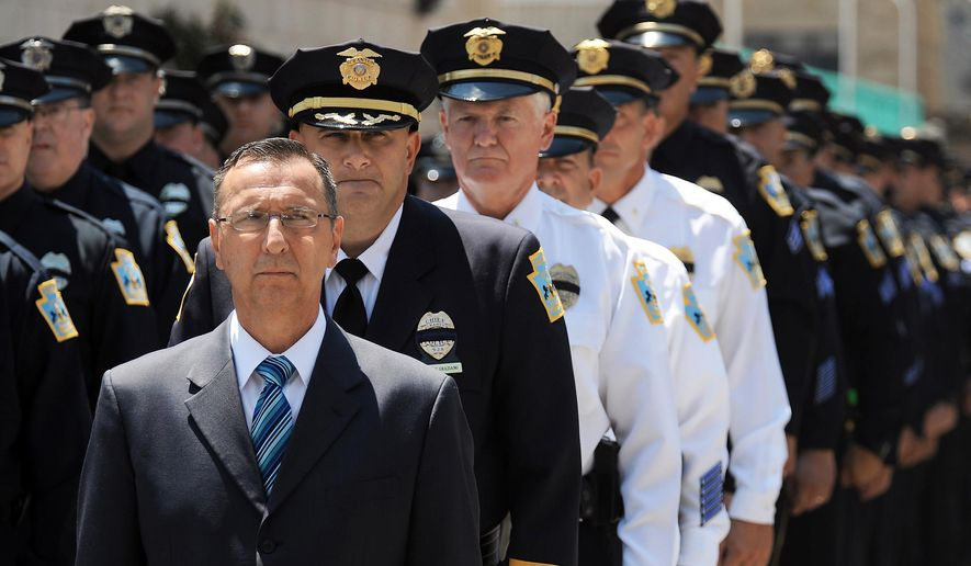 Standing in line from front, Scranton Mayor Bill Courtright,  Scranton Police Chief Carl Graziano, and Scranton Police Lt. Martin Crofton along with many Scranton Police officers, prepare to enter Lackawanna College on Thursday, July 16, 2015, in downtown Scranton, Pa., for the public viewing of fallen Scranton Police Patrolman John Wilding. (Butch Comegys / The Scranton Times-Tribune via AP)  WILKES BARRE TIMES-LEADER OUT; MANDATORY CREDIT