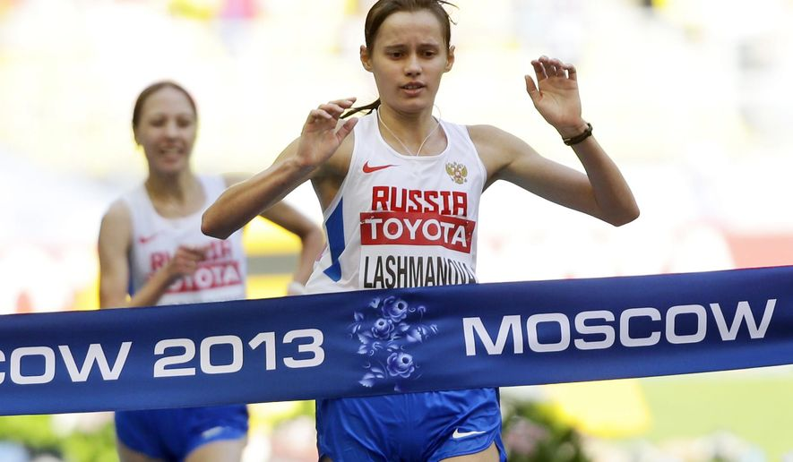"""FILE - This is a Tuesday, Aug. 13, 2013  file photo of Russia's Elena Lashmanova as she crosses the finish line to win the women's 20 kilometer race walk final at the World Athletics Championships in the Luzhniki stadium in Moscow, Russia.  Russia said Thursday July 16, 2015  it has withdrawn its world-beating team of race-walkers from all international competitions to avoid """"disgrace"""" in the wake of a series of doping allegations. Russia won two of the three walk events at the 2013 world athletics championships. One of those gold medalists, Elena Lashmanova, was banned for doping a year later, but kept her world gold medal and the Olympic gold she won in 2012. (AP Photo/Anja Niedringhaus, File)"""