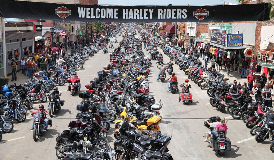 FILE - In this Aug. 3, 2014, file photo, motorcycles and their riders line the streets of downtown Sturgis, S.D., for the 74th annual Sturgis Motorcycle Rally. Organizers expect 1 million people for the weeklong 75th annual rally which begins Aug. 3, 2015. (Katie Adkins/Rapid City Journal via AP, File) TV OUT; MANDATORY CREDIT