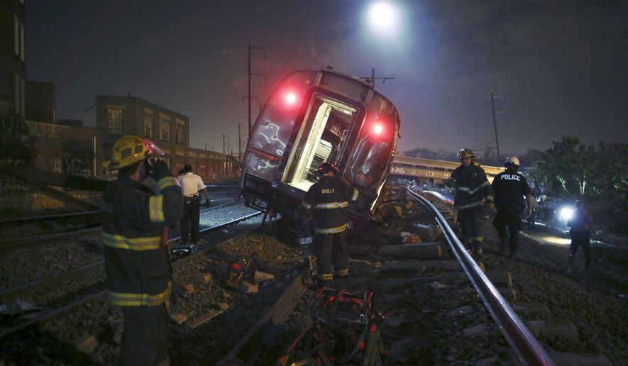 FILE - In this May 12, 2105 file photo, emergency personnel work the scene of a deadly train wreck in Philadelphia. An Amtrak train headed to New York City derailed and tipped in Philadelphia. Despite several years of horrific oil train wrecks and record car and truck recalls, congressional Republicans have decided that the auto and railroad industries suffer from too much safety regulation, not too little. (AP Photo/ Joseph Kaczmarek, File)