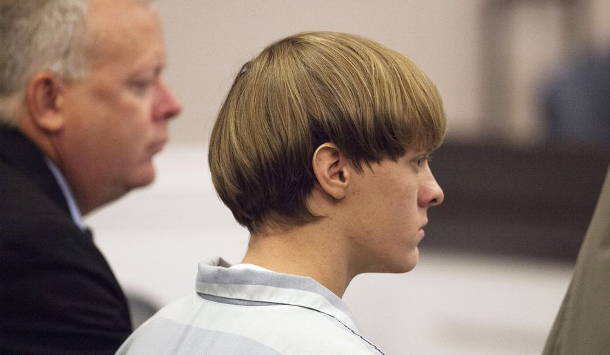 Dylann Roof appears at a court hearing in Charleston, S.C., on Thursday, July 16, 2015. A judge ruled Thursday that Roof, accused of killing nine people at the Emanuel AME Church in Charleston in June, will stand trial in July 2016. (Randall Hill, Pool Photo via AP) ** FILE **