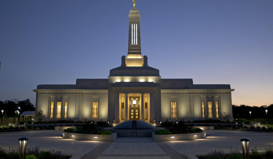 This July 14, 2015 photo, shows the Indianapolis Indiana Temple of The Church of Jesus Christ of Latter-day Saints, crowned with a gilded statue of the angel Moroni, in Carmel, Ind. The temple opens Friday, July 17 for three weeks of public tours before its dedication next month makes it off-limits to non-Mormons. (AP Photo/Michael Conroy)