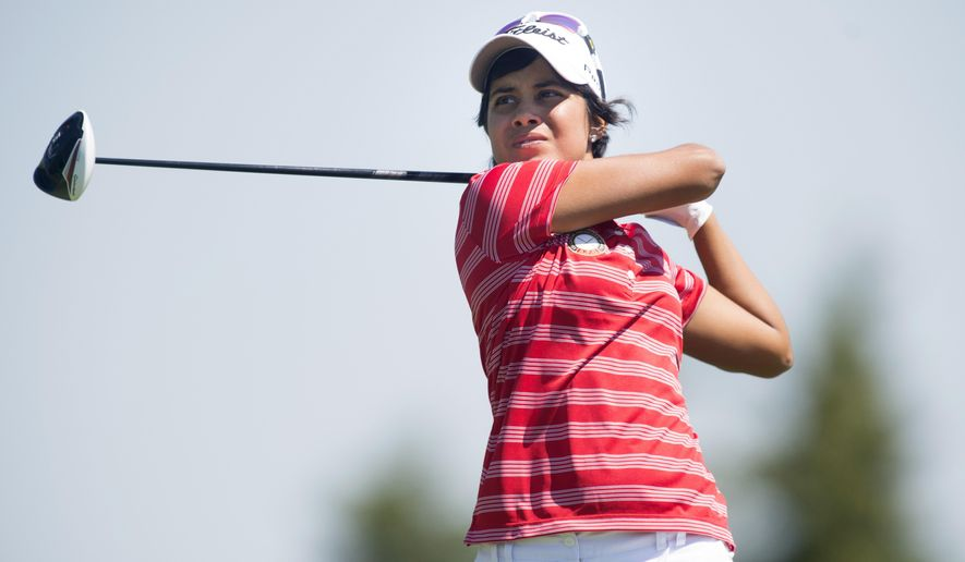 Paraguay's Julieta Granada hits a tee shot in women's individual golf at the Pan Am Games at Angus Glen Golf Club in Markham, Ontario, Thursday, July 16, 2015. Golf made its debut Thursday at the Pan Am Games, a warm-up as it prepares to rejoin the Olympic family next year in Rio de Janeiro after a 112-year absence. (Darren Calabrese/The Canadian Press via AP)