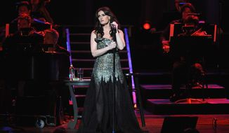 "Idina Menzel came to the concert stage by way of Broadway, having originated the role of Maureen Johnson in ""Rent"" and ""Wicked"" with Kristen Chenoweth. (Associated Press)"