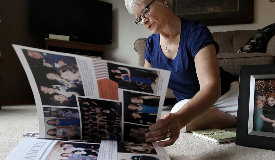 ADVANCED FOR RELEASE SATURDAY, JULY 18, 2015 Terry Flugaur peruses memories of her deceased daughter and organ donor, Kiley Hackl, in her home in Wisconsin Rapids, Wis. Thursday, June 11, 2015. (John Hart/Wisconsin State Journal via AP) MANDATORY CREDIT