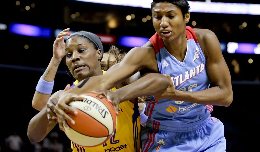 Atlanta Dream's Angel McCoughtry, right, blocks a shot by Los Angeles Sparks' Jantel Lavender during the first half of an WNBA basketball game in Los Angeles, Thursday, July 16, 2015. (AP Photo/Chris Carlson)