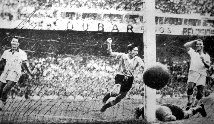 FILE.- Uruguay player Ghiggia scores during the World Cup Final, against Brazil, in the Maracana Stadium in Rio de Janeiro, Brazil, July 16, 1950 . Uruguay defeated  Brazil 2-1 to win the 1950 World Cup.  Alcides Edgardo Ghiggia, who scored the winning goal in the final game of the 1950 World Cup to give Uruguay a stunning 2-1 victory over Brazil,  still recalled as Brazil's greatest defeat,  has died. He was 88.(AP Photo,File)