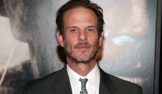 "Director Peter Berg attends the New York premiere of ""Lone Survivor"" on Tuesday, Dec. 3, 2013, in New York. (Photo by Andy Kropa/Invision/AP)"