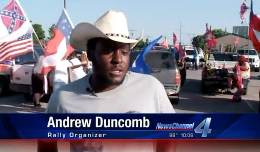 President Obama was greeted in Oklahoma City Wednesday night by people waving Confederate flags in a protest organized by Andrew Duncomb, a local black resident who insists the flag doesn't symbolize racism. (KFOR)